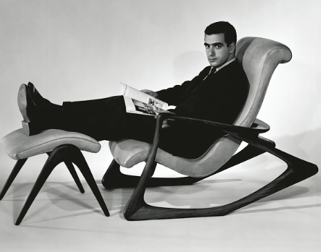 A 28 year old Kagan in his Two Position rocker and ottoman, 1955. Image by Herman van Ness, courtesy of Vladimir Kagan Design Group Photography by Hans van Ness.